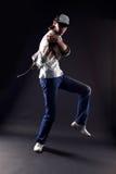 Cool man modern dancer. Against black stock photos