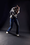 Cool man modern dancer. Against black royalty free stock photography