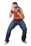 Cool man photographer with camera in sniper pose Stock Photography