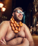 Cool man with sausages Royalty Free Stock Photos