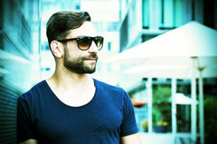 Cool man with sunglasses in the city. Portrait of a young man with sunglasses Royalty Free Stock Photos