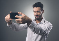 Cool man taking a selfie Stock Photography