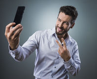 Cool man taking a selfie Stock Photos