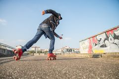 Cool man wearing roller skating shoes Royalty Free Stock Photo