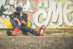 Cool man wearing roller skating shoes Royalty Free Stock Photography