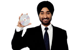 Cool manager showing compact disc Royalty Free Stock Photography