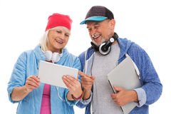 Cool mature couple having fun with technology Royalty Free Stock Image