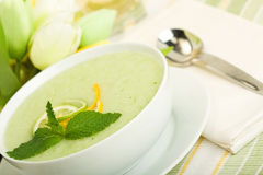 Cool Melon Soup. Cool Refreshing Citrus Mint Melon soup presented with  citrus garnish and mint leaf Royalty Free Stock Photography