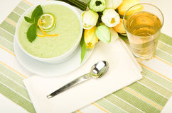 Cool Melon Soup. Cool Refreshing Citrus Mint Melon soup presented with  citrus garnish and mint leaf Stock Photo