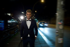 Cool man. Male fashion model posing in a night street Stock Photo