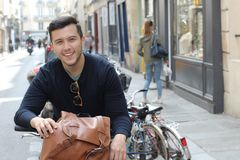 Cool millennial in the city with a bicycle royalty free stock photo