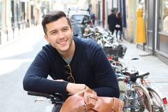 Cool millennial in the city with a bicycle royalty free stock images