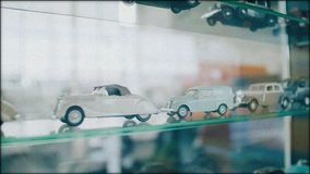 Cool models of vintage cars in a glass case. Close up. The camera is in motion. Vintage video stock video footage