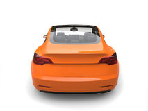 Cool modern electric car - heat wave orange paint - back view Stock Image