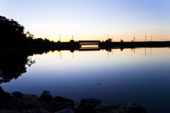 Cool Morning Bridge. Cape Breton Bridge at Sunrise showing Mirror Reflection and Cool Colors Stock Images