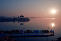 Cool morning Sunrise at Sukhna Lake chandigarh. Cool environment at Sukhna Lake chandigarh. Red and blue sky and reflection on water. Colourful botes in lake stock photography