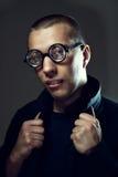 Cool nerd in glasses. Sexy, cool nerd in glasses flirting royalty free stock image