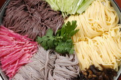 Cool noodle. Is made of different natural grains, mushrooms, spice plants, delicious and beautiful, a popular chinese food Royalty Free Stock Image