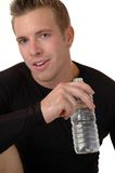 Cool Off. An athlete drinking water to cool off after a workout Stock Photos