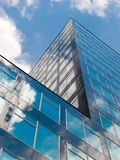 Cool Office. Modern high rise with cloud reflecting facade, Bochum, Northrhine-Westphalia, Germany Stock Image