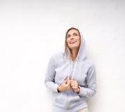 Cool older woman laughing with hood sweatshirt Royalty Free Stock Image