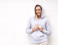 Cool older woman smiling with hood sweatshirt Stock Image