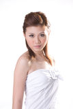 Cool oriental girl 2. Beautiful cool oriental girl wearing a white tube top with big buckle Royalty Free Stock Image