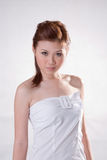 Cool oriental girl. Beautiful cool oriental girl waeing a white tube top with big buckle Stock Photos
