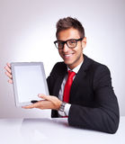 This is a cool pad. Young business man presenting his new and cool tablet pad Stock Photos