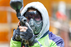 Cool paintball player aiming in camera. Closeup. Royalty Free Stock Photography