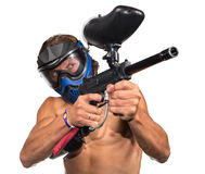 Cool paintball player with marker on white background. Cool paintball player with marker ans mask on white background isolated Royalty Free Stock Images