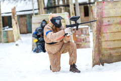 Cool paintball in winter. Two shooters behind fortifications. Royalty Free Stock Image