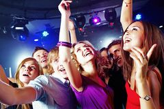 Cool party. Image of pretty girls dancing with their boyfriends in night club Stock Photo