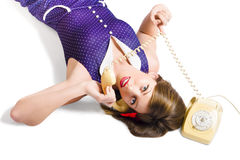 Cool pin-up girl making conversation on telephone Royalty Free Stock Photo