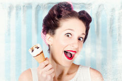 Cool pin-up woman in cold freezer with ice-cream Stock Photos