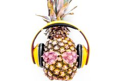 Cool pineapple in sunglasses is music lover. White background top view copyspace Royalty Free Stock Photography