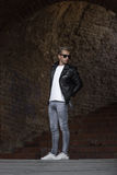 Cool posing young man fashion leather jacket casual clothes jean. S Stock Photos