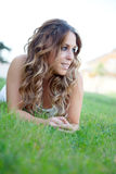 Cool pretty girl lying on the grass Stock Photos