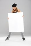 Cool Pretty Woman in Bonnet Holding White Board Royalty Free Stock Images
