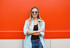 Cool pretty woman in sunglasses outdoors posing in urban style Stock Images
