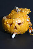 Cool pumpkin. Little halloween pumpkin with cigarette Royalty Free Stock Images