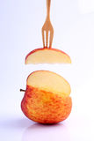 Cool red apple on fork  on white background Royalty Free Stock Images