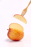 Cool red apple on fork  on white background Stock Image