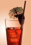 Cool red drink. Red drink with ice and straw royalty free stock photos