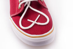 Cool red shoe. Laces of Cool red shoe forming a heart shape on a white background Royalty Free Stock Images