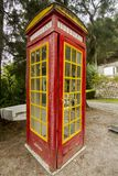 Cool red and yellow phone booth Royalty Free Stock Photos
