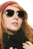 Cool redhead woman wearing sunglasses in winter dr Stock Photo