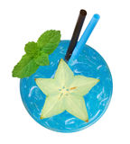Cool refreshing blue cocktail with sliced star apple fruit and m Royalty Free Stock Images