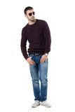 Cool relaxed casual man in jumper with sunglasses looking away. Full body length portrait isolated over white studio background Stock Photography