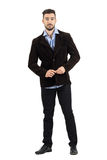 Cool relaxed man buttoning corduroy jacket looking at camera Stock Images